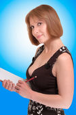 Attractive woman holding a notebook — Stok fotoğraf