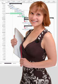 Attractive woman holding a notebook — Stockfoto
