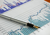 Pen on stock chart — Stock Photo