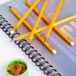 Sharpening pencils on a notepad — Stock Photo