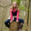 Girl in tree - Stock Photo