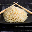 Plate rice with chopsticks — Stock Photo