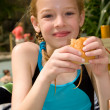 Girl in swim pool eating bread — Stock Photo #2743116