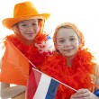 Two girls in orange outfit — Stock Photo