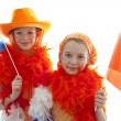 Two girls in orange outfit — Stock Photo #2761557