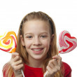Young girl with lollipops — Stock Photo