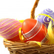 Cane basket with colorful easter eggs — Stock Photo #2761794