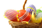 Cane basket with colorful easter eggs — Stock Photo