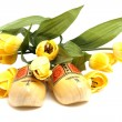 Dutch wooden shoes and silk tulips — Stock Photo