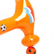 Hammer over orange soccer ball — Stock Photo