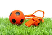 Orange soccer ball and flute — Stock Photo