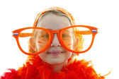 Soccer supporter with big orange glasses — Stock Photo