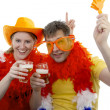 Two Dutch soccer fans in orange outfit — Stock Photo