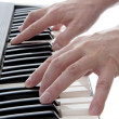 Stock Photo: Hands are playing piano