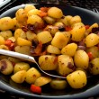 Plate with fresh baked potatoes - Stock Photo