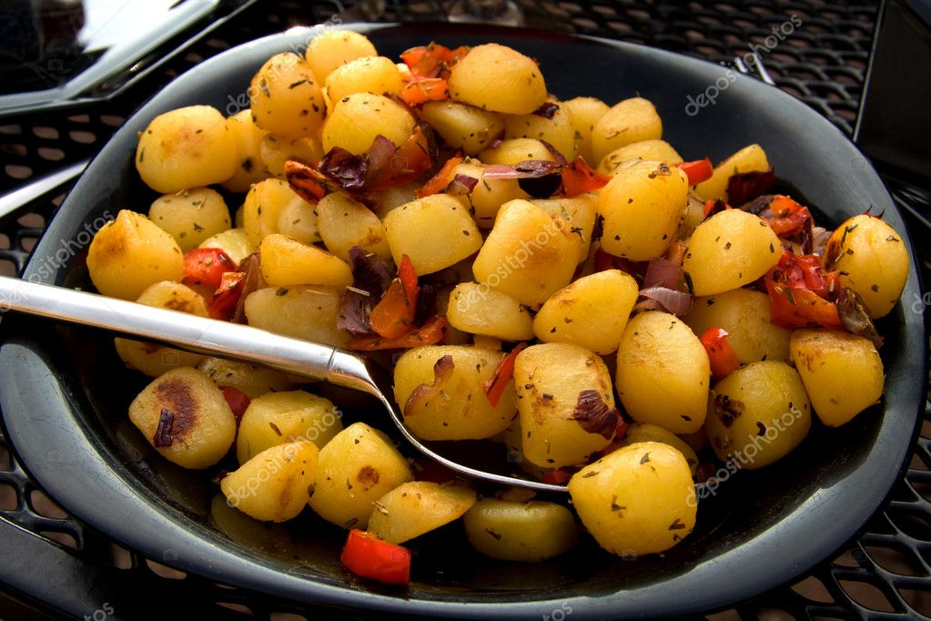 Plate with fresh baked potatoes ready to eat  Stock Photo #2976642