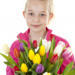 Girl with colorful Dutch tulips — Stock Photo