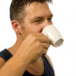 Man drinks his coffee - Stock Photo