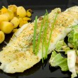 Stock Photo: Plate with fish, potatoes and lettuce