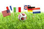 Banderas y la bola en campo de fútbol — Foto de Stock