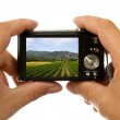 Hands with camera taking picture — Stock Photo