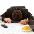 Businessman lies with head on desk — Stock Photo