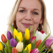 Woman with Dutch tulip flowers — Stock Photo