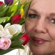 Royalty-Free Stock Photo: Woman with Dutch tulip flowers