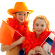 Two girls posing in orange outfit — Stock Photo