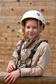Young girl posing before climbing wall — Foto de Stock