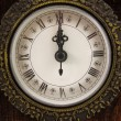 Clock strikes twelve o'clock — Stockfoto