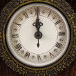 Clock strikes twelve o&#039;clock - Stockfoto