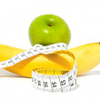 Apple and banana with measure tape — Stock Photo