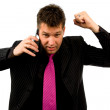 Angry businessman is calling on the phone — Stock Photo