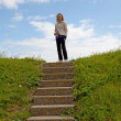 Girl on top of a stairs — Stock Photo