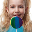 Young blonde girl with lollipop — Stock Photo