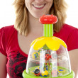 Woman is holding play toy — Stock Photo #3313658