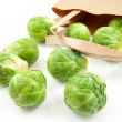 Brussels sprouts fallen out of paper bag — Stock Photo
