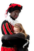 Girl is hugging black pete — Stock Photo