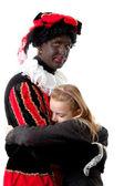 Girl is hugging black pete — Стоковое фото