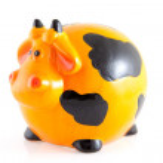 hucha en forma de vaca naranja — Foto de Stock