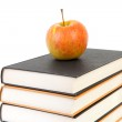 Stack of books with apple — Stock Photo