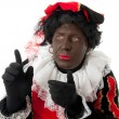 Zwarte piet ( black pete) typical Dutch character — Stock Photo #3777928
