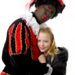 Girl is hugging black pete — Stock Photo #3777932