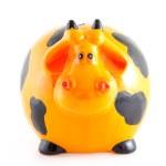 Piggy Bank in Form von orange Kuh — Stockfoto