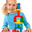 Girl is playing with colorful wooden blocks — Stock Photo
