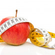 Apple with measure tape for diet — Stock Photo