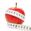 Apple with measure tape for diet — Stock Photo #3861437