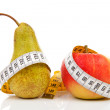 Pear and apple with measure tape — Stock Photo