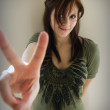Girl giving peace sign — Stock Photo